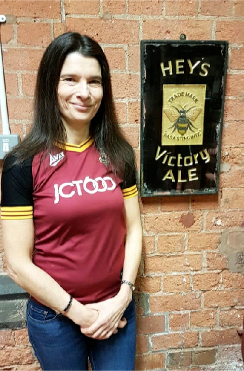 Kathryn Hey photgraphed next to a Hey's Victory Ale plaque at the National Brewery Centre, Burton Upon Trent.
